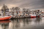 Thumbnail image of Old buildings and boats on the Alter Strom, Warnemuende, Mecklenburg Vorpommern, Germany
