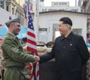 Thumbnail image of Kim Jong Un impersonator with border guard at Checkpoint Charlie, Berlin