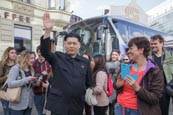 Thumbnail image of Kim Jong Un impersonator at Checkpoint Charlie, Berlin