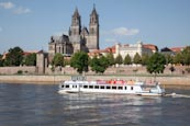 Thumbnail image of tourist boat on the River Elbe with the Cathedral and Fürstenwall, Magdeburg, Saxony Anhalt, Germany