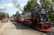 Thumbnail image of Steam train at Drei Annen Hohne with tourists boarding, Saxony Anhalt, Germany