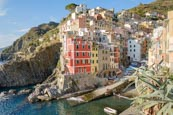 Thumbnail image of view over the town and harbour with its colourful houses in Riomaggiore, Cinque Terre, Liguria, Ital