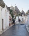 Thumbnail image of Typical trulli with gift shops in Alberobello, Puglia, Italy