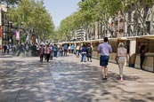 Thumbnail image of people walking on La Rambla with art and souvenir stalls, Barcelona, Catalonia, Spain